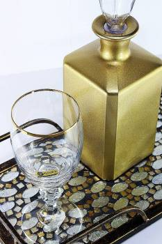 Set golden decanter in metal tray